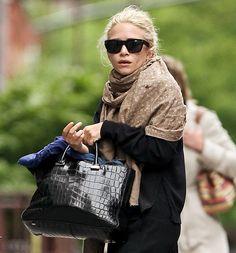 ESSENTIALS: serious bag, black sweater, soft pashmina, dark glasses.