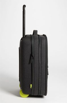 Incase 'EO' Roller Suitcase | Nordstrom. What we love about this bag: 1. feels light when rolling (even when it's full of lemons and heavy to actually lift); 2. fits more clothes than you would expect; 3. the front compartment has custom pockets for pens, devices, papers, laptop, cords and so on; 4. the back compartment has a deep section with mesh to hold your clothes in and a pocket for toiletries; 5. clothes are kept in a completely separate section from work supplies.