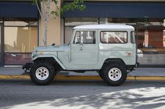 A classic landcruiser...the color even makes me swoon.
