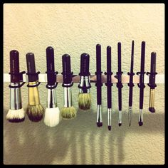 This is genius.  Towel bar and hairbands to hang make-up brushes for drying (after washing w/ tea tree castile soap - Bronner's - and olive oil w/ a touch of tea tree oil for disinfecting).