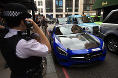 Busy: The Qatari registered vehicle was parked on a singe red line outside the upmarket department store while its owner shopped inside Center Stage, Lamborghini, Super Cars, Mercedes Benz, Vehicle, London, Department Store, Street, Red