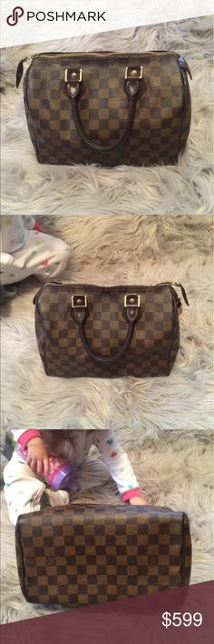 LV Damier Ebene Speedy 25 DE speedy 25 in EUC!  Inside needs cleaned. All piping is intact. Only flaws are minor cracking on the canvas along the zipper and the inside pocket is peeling. Date code SD 2007. Don't have the key but the lock is #305. Made in USA. Ignore my daughter in the background 😂 she loves bags too lol! Louis Vuitton Bags