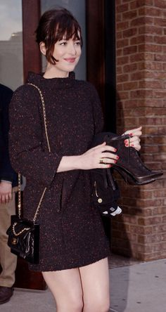 Dakota Johnson leaving her NY hotel to attend the #CruiseWithKarl event at Chelsea Pier. - 30 March 2015.