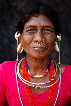 Lanjiya Soura tribal woman with traditional piercings, ear plugs and tattoos. Orissa, India.