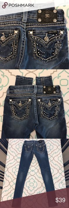 "💙👖Super Cute! Miss Me Jeans👖💙24 00 31"" Skinny! 💙👖Super Cute Miss Me Jeans👖💙 Size 24 (00). Extra Extra Small. Skinny Jeans! 31.25"" Inseam. 6.5"" Rise. Low Waist. 12.75"" Across Back. Great Stretch. Medium Blue Wash. Cute Whiskering. Medium Fading. White Thick Stitching. Bling! Some missing. It's an overall random pattern so not too noticeable really. Small stains on thigh. Priced Accordingly! Beautiful Look! Miss Me! The Buckle! Ask me any questions! : ) Miss Me Jeans Skinny"