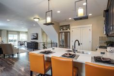 Sleek black light fixtures and railings define the Manhattan plan, a new townhome built by Oakwood Homes at Avenues at the Station. Farmington, UT.