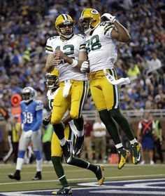 Packers Lions Football - Aaron Rodgers, Jermichael Finley  Green Bay Packers quarterback Aaron Rodgers (12) and tight end Jermichael Finley (88) celebrate after FInley's 20-yard touchdown reception against the Detroit Lions in the second quarter of an NFL game in Detroit, Sunday, Nov. 18, 2012. (AP Photo/Paul Sancya)