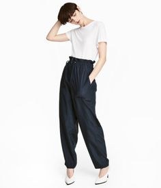 Dark blue. Oversized pants in Tencel® lyocell-blend fabric. Elasticized, ruffle-trimmed drawstring waistband. Dropped gusset, zip fly, side and back pockets