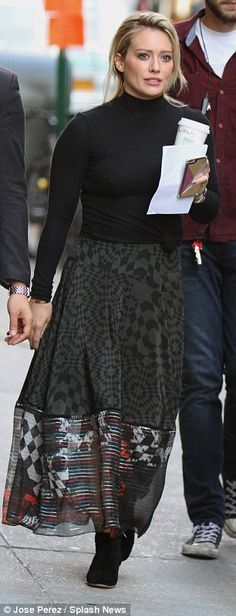 Round one: The actress turned singer kicked off her day in a long printed flowing skirt th...