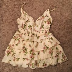 Cavender's Ruffled Tank Got this tank from Cavender's and never wore it. It's super cute and doesn't have any rips or stains. Cream color with floral pattern. The straps are adjustable in length. GREAT condition!! Cavender's Tops Tank Tops