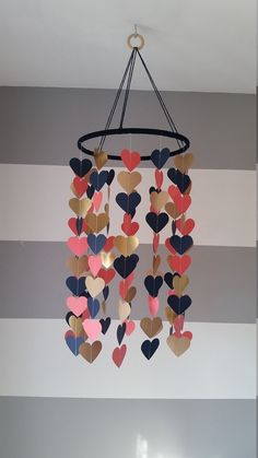Heart shape paper mobile. Navy coral and gold. Baby room