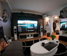 """Found on Swedish home tech forum Min Hembio, on member Z3m-Johan's page, this entertainment pad leaves no stone unturned.  For the tech savvy, here is the list: Audiovector AV3Ci Avantgarde , Audiovector S3 Avantgarde , Euroscreen Frame Vision Light VLS190-W 16:9 86 """"(190x107) , Logitech Illuminated Keyboard K800 (S) , NAD 32A2 , Philips Prestigo SRT9320 , Primare CD31 , Primare SPA22."""