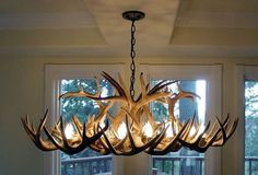 You'll love this dramatic authentic White-Tail Deer antler chandelier the first time you see it. It will add just the rustic touch that you've been wanting for any cabin, lodge, mountain or vacation h