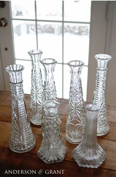 A collection of glass bud vases can be easily turned into great distressed candlesticks!