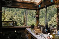 IMAGINE a kitchen view like this!!!  I love cabins and cozy getaways in the woods