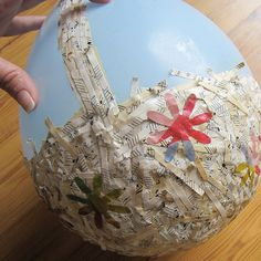 DIY Recycled Paper Easter Basket - I think using coloured tissue paper on the exterior would create a better finish