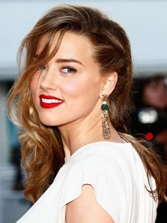 Statement Earrings are Trending at Cannes 2014. Amber Heard in statement tassel #earrings at the Red Carpet during Cannes Film Festival 2014 #Cannes2014 #trendy #jewelry