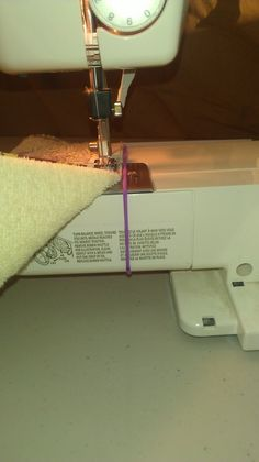Hair tie on sewing machine for strait lines.