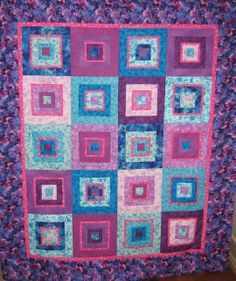 This interesting pattern comes to us from Lizzie of Lizzie's Handmade Originals and features a colorful variation on the courthouse step block pattern.  This is from the same Lizzie for whom the TinLizzie18 longarm quilting machines were named (read her story on her About Lizzy page!).  Enjoy!  http://www.freequiltpatterns.info/free-pattern---square-pegs-by-lizzie.htm