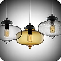I came across these lights when doing research for solving a clients interior design problem - I find some of the products can straddle the modern/traditional styles.  You can pick  warmer glass colors and styles if you are bridging a modern space with traditional furniture or alternatively if you want to modernize a traditional space these can work wonders.  Never underestimate the value of lighting!