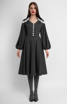 Slim-fit true wool dress with bell-shaped sleeves. Lace and bead trim. Silk covered buttons.