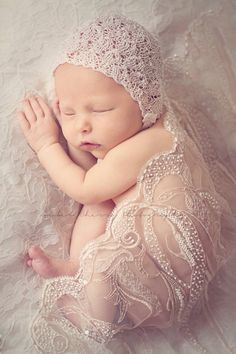 Amber cherry photography - what a cute photo!! Baby under mums wedding dress