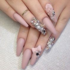 Long matte pink coffin nails