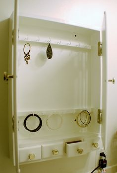 Inside the Jewelry cabinet. So much better than a basket full of tangled necklaces and missing earrings :)