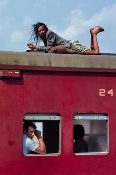 Steve McCurry: Train from Dhaka to Chittagong, Bangladesh.