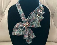 Necktie Necklace   Etsy Scarf Necklace, Fabric Necklace, Textile Jewelry, Fabric Jewelry, Old Ties, Tie Crafts, Ways To Wear A Scarf, Mens Silk Ties, Tie Styles