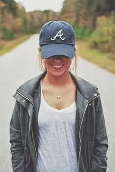 .comfy casual: loose white shirt, baseball cap, hopped earrings and a simple necklace
