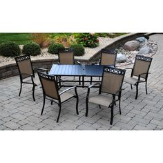 Seven piece dining set that ships in one box. Six stationary dining chairs with decorative metal header around a slat dining table.