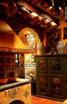 Mexican kitchen-- I would love to cook in a place like this, rustic and beautiful, lots of tile.