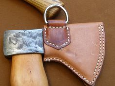 Stitched leather ax sheath. MXS Make one for the machete and the scythe.