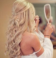 Simple and really cute half updo. Backcombing at the crown gives volume and loose curls are soft and romantic.
