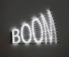 BOOM - James Clar  2011  85 x 120 cm  Fluorescent lights, acrylic tubes and light filters  Edition of 5 + 2 AP  Wall mounted fluorescent tube lights with laser cut light filters spell out the word BOOM. The action of the word as it starts focused on one end and explodes towards the other, visually represents the meaning of the word.