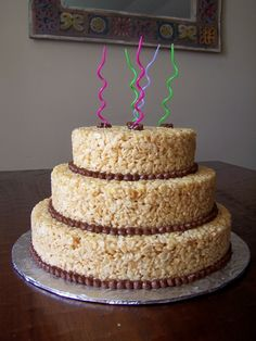 Another one! Rice Krispie Treat Cake. I think I would like 1 regular layer (the biggest layer) and maybe 2 specialty layers . .