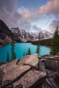 Moraine Lake - Moraine Lake is a glacially fed lake in Banff National Park, 14 kilometres (8.7 mi) outside the Village of Lake Louise, Alberta, Canada. It is situated in the Valley of the Ten Peaks.  The lake, when it is full, it reflects a distinctive shade of azure blue. The unique colour is due to the refraction of light off the rock flour deposited in the lake on a continual basis by surrounding glaciers. Banff National Park, National Parks, Refraction Of Light, Moraine Lake, Canadian Rockies, Unique Colors, The Rock, Alberta Canada, Mountains