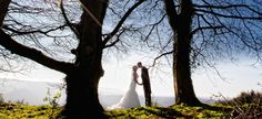 Beautiful countryside wedding shot in amongst the trees at the Devon wedding venue Horn of Plenty