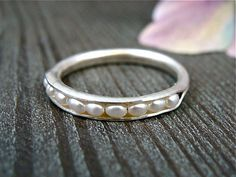 Hey, I found this really awesome Etsy listing at https://www.etsy.com/listing/191016396/petite-pearl-stack-ring