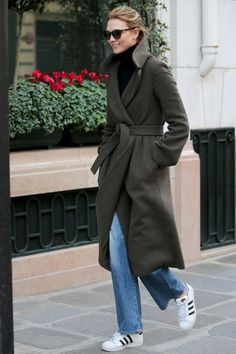 5 March Karlie Kloss paired her green coat with blue jeans and Adidas trainers while out and about in Paris.