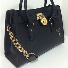 Brand new Michael Kors large black Hamilton Brand new & authentic Michael Kors large Hamilton still in the wrapping. Received as a gift. No trades! Michael Kors Bags