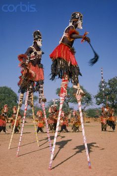 Africa   A group of Malians wear stilts and elaborate costume as they perform a ritual dance. Pays Dogon, Mali.   Image and caption © Charles & Josette Lenars