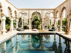 """How to stay like royalty in Morocco. @cntraveler via @topupyourtrip """" Ever wanted to rule your own kingdom? At Palais Namaskar you can—for a night, at least. This sanctuary, located in the desert-and-palm-grove Palmeraie region about 25 minutes from Marrakech, boasts three large private palaces within its 12-acre compound. The front terrace of the gold-domed Pool Palace is shown here; its lagoon-filled layout includes multiple bedrooms, each with a plunge pool, and a grand private pool."""