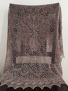 http://www.ravelry.com/patterns/library/flower-and-garden-shawl
