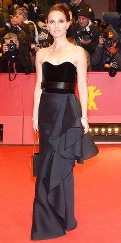 Look of the Day - February 09, 2015 - Natalie Portman stunned at the Knight of Cups premiere at the Berlinale International Film Festival in a custom black strapless Lanvin gown with a velvet bustier and taffeta ruffle skirt, styled with a black satin belt, a white floral Lanvin evening minaudiere, and Sidney Garber jewelry. Sartorial perfection!