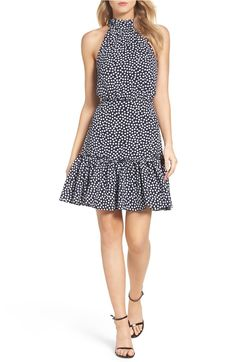 Both feminine and chic, this fit & flare halter dress is perfect for any summer occasion