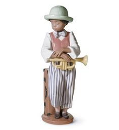 Lladró is a Spanish brand dedicated since 1953 to the creation of art porcelain figurines at the brand's only factory in the world, in Valencia. Jazz, African American Figurines, Black Figurines, Black Art, Decoration, Art Forms, Horns, Sculptures, Ceramics