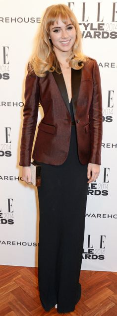 British model Suki Waterhouse wearing a Burberry dress and satin trim jacket at the Elle Style Awards in London