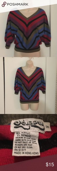 Retro 1980s dolman sleeve sweater Totally authentic! Multi color stripes.  Can be worn up on the waist or pulled down over leggings.  Has metallic threads going through it but they are subtle.  Good for daytime and definitely for a night out!  It's a small but I think it could also work for medium. Sweaters V-Necks